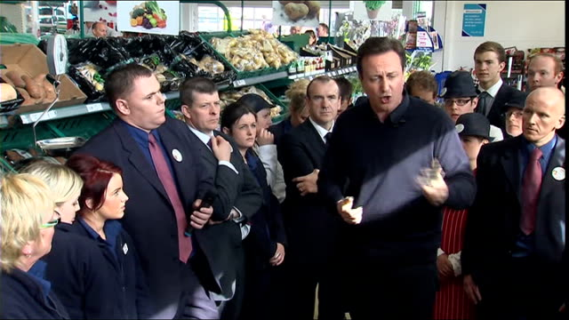 cameron visits tescos q would you take away postcode lottery cameron reply sot talks of cancer drugs fund q will you work with plaid govt cameron... - schottenkaro stock-videos und b-roll-filmmaterial