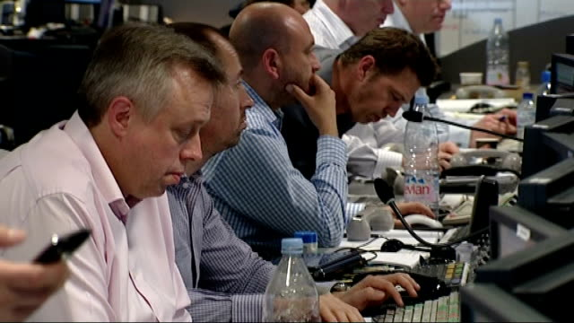 general election 2010: city traders at bgc partners on the day of the results; england: london: ext various general views of stock market traders... - market trader stock videos & royalty-free footage