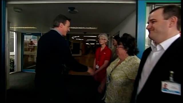 Conservative Leader David Cameron visits maternity ward in Stevenage ENGLAND Hertforshire Stevenage EXT Conservative Party battle bus pulls up...