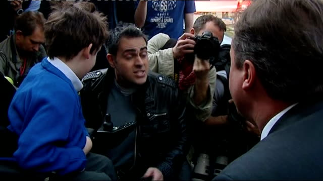conservative party campaign father of disabled child confronts david cameron england london lambeth kennington ext jonathan bartley crouched by his... - lambeth stock videos & royalty-free footage