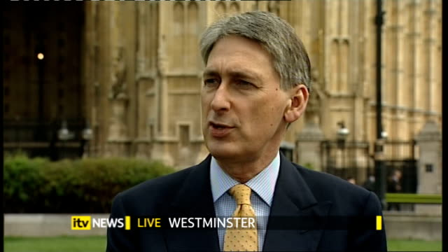 Conservative Party spending plans ENGLAND London Westminster EXT Philip Hammond MP Stephen Timms MP and Ed Davey MP debate the Conservative Party's...
