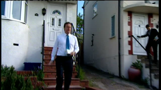 David Cameron campaigning in Hendon More of Cameron posting leaflets Cameron commenting to journalist on hung parliament SOT senior Labour...