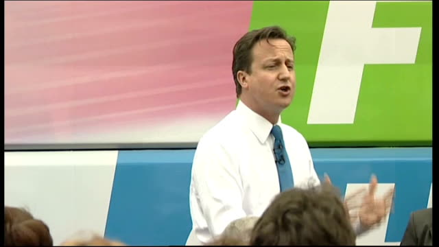 vídeos de stock, filmes e b-roll de david cameron campaigning in loughborough wide shot of tory supporters david cameron addressing supporters with battle bus in background sot when we... - savory food