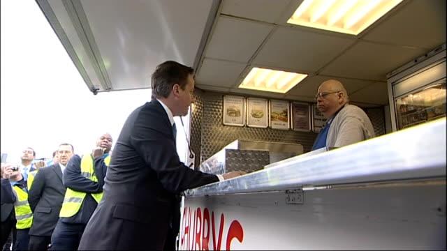 david cameron visits chubby's burger van in reading england berkshire reading ext **flash photography** david cameron mp along to roadside burger van... - tea cup stock videos and b-roll footage