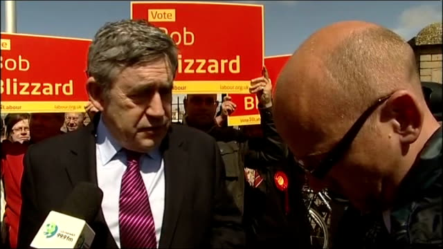 general election 2010: gordon brown campaigning in lowestoft; brown shaking hands with young labour supporters holding placards / brown looking at... - gordon brown stock-videos und b-roll-filmmaterial
