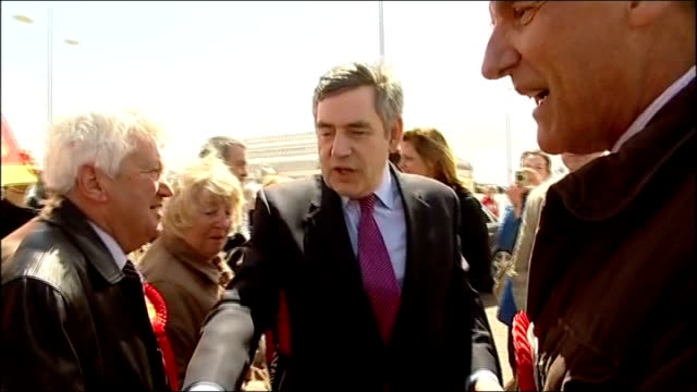 general election 2010: gordon brown campaigning in lowestoft; england: suffolk: lowestoft: ext labour supporters holding 'vote labour' placards / man... - ローストフト点の映像素材/bロール