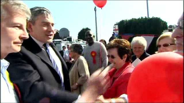 gordon brown meets bedworth party activists england warwickshire bedworth ext gordon brown arrives in car to crowd of people clapping holding red... - warwickshire stock videos & royalty-free footage