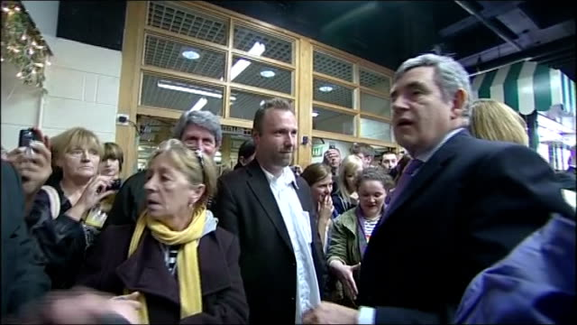 general election 2010: gordon brown walkabout in skelmersdale; brown thanking people then leaving cafe / brown speaking to woman, saying 'i'll get... - shaky camera stock videos & royalty-free footage