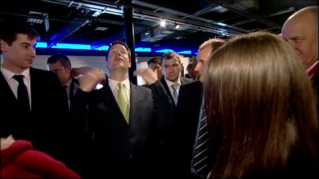 general election 2010: nick clegg visits at-bristol science museum; clegg chatting to visitors to museum / museum curator showing clegg a pendulum /... - curator stock videos & royalty-free footage
