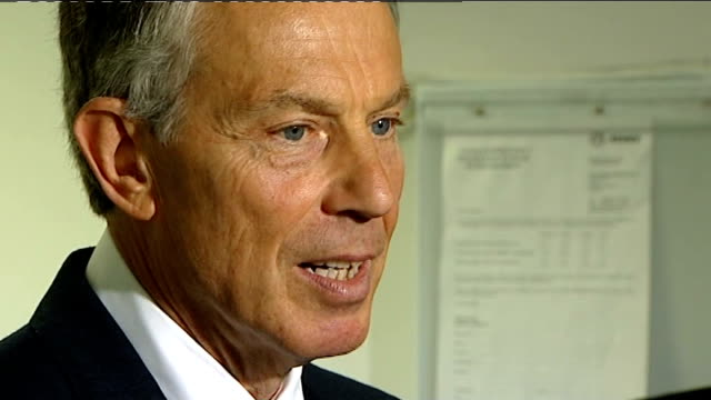 tony blair visits harrow clinic blair arrival at clinic blair arrival at clinic int tony blair having microphone attached to his jacket ahead of... - harrow stock videos & royalty-free footage