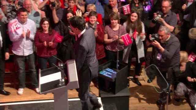 campaigning england cheshire warrington int ed miliband shaking hands with members of audience and waving as to stage at labour rally members of... - ben elton stock videos and b-roll footage