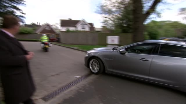 campaigning finchley ext motorcade of cameron along for closed election meeting pan reporter to camera sot - motorcade stock videos & royalty-free footage