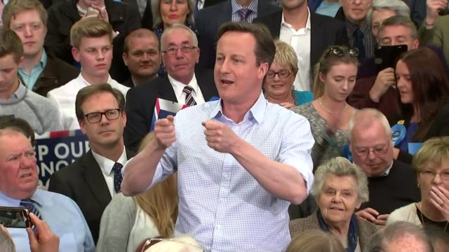 general election 2015: conservative: david cameron campaigning; england: cumbria: carlisle: int david cameron shaking hands with supporters at rally... - mid wales stock videos & royalty-free footage