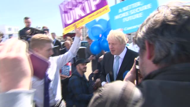 conservatives boris johnson campaigning in thanet ramsgate ext ukip supporters along with placards johnson along as ukip supporters try to follow him... - ramsgate video stock e b–roll