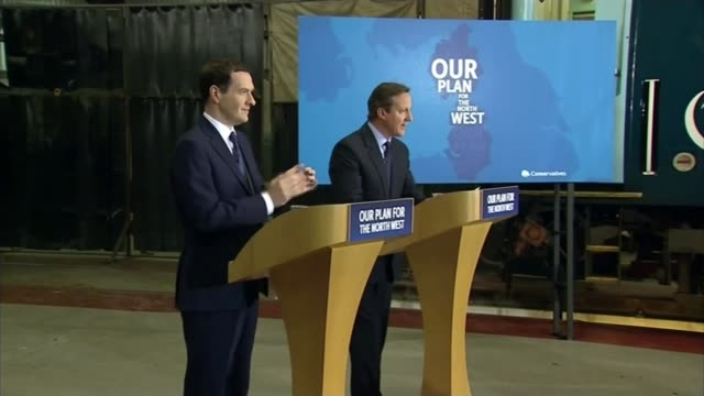 Conservatives campaigning in North West England ENGLAND Crewe INT David Cameron and George Osborne along at Arriva train depot Audience Cameramen and...