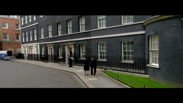 conservatives win majority / opposition party leaders resign england london downing street ext david cameron mp and his wife samantha cameron walk... - allgemeine wahlen stock-videos und b-roll-filmmaterial