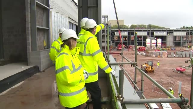 david cameron visits construction site in birmingham england west midlands birmingham ext various shots of david cameron and others visiting... - construction vehicle stock videos & royalty-free footage