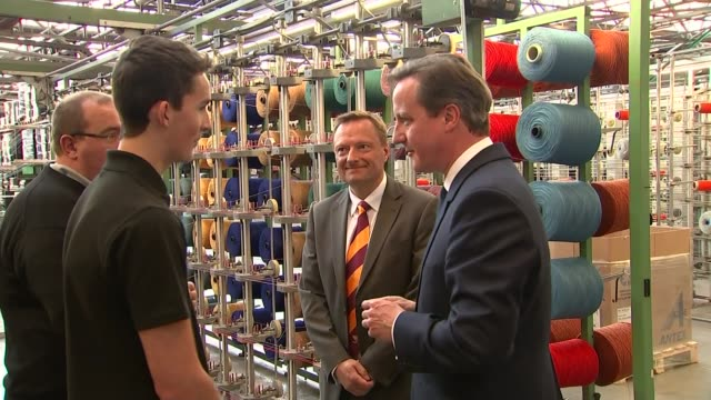 defence david cameron visits huddersfield fabric factory england west yorkshire huddersfield camira fabrics int varios of large spools of coloured... - trident stock videos & royalty-free footage