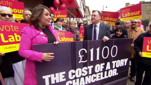 ed balls campaigning in dewsbury ed balls and paula sheriff posing with poster saying that '1100 pounds the cost of a tory chancellor' as surrounded... - party poster stock videos & royalty-free footage