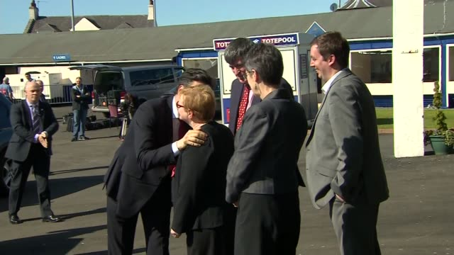 general election 2015: ed miliband arrives at ayr racecourse; scotland: ayr: ext car arriving / ed miliband out of car and shaking hands / miliband... - ayr stock videos & royalty-free footage
