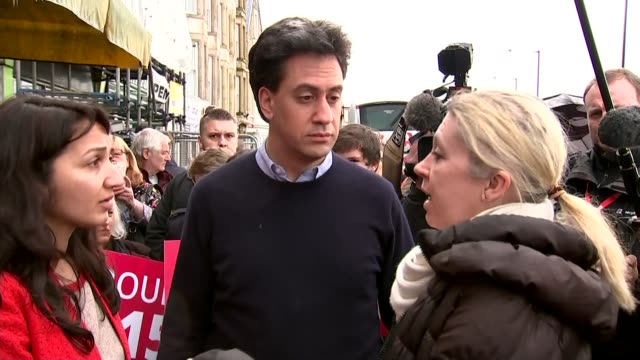 ed miliband walkabout in morecambe england lancashire morecambe ext ed miliband form labour campaign bus battlebus and greeted by amina lone /... - ed miliband stock-videos und b-roll-filmmaterial