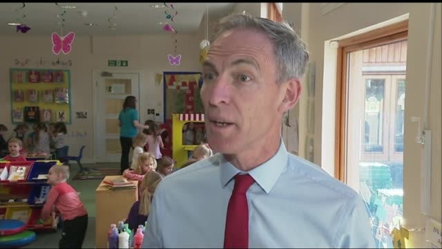 Final day of campaigning in Scotland Greenock Enchanted Forest Nursery INT Jim Murphy and children posing with their hands painted red Murphy and...