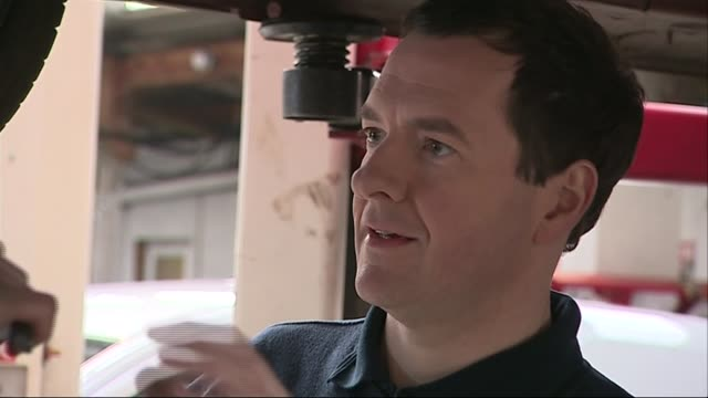 george osborne at mechanics in st austell england cornwall st austell hawkins garage photography*** gvs george osborne with apprentices working... - st austell stock videos & royalty-free footage