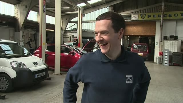 vídeos de stock e filmes b-roll de george osborne visits car repair garage in st austell various of george osborne standing drinking tea and chatting with car mechanics/ george osborne... - st austell