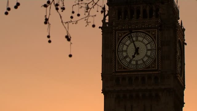 general election 2015: houses of parliament at sunrise; ** audio fault - incorrect audio - contains audio from another clip ** england: london:... - dawn stock videos & royalty-free footage