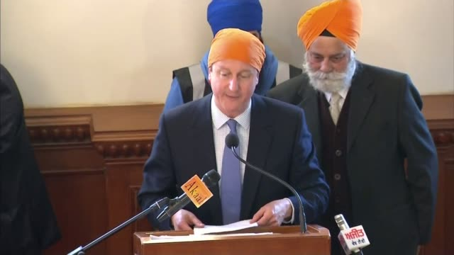 issues immigration england kent gravesend photography*** david cameron along among sikhs during visit to sikh temple int cameron and wife samantha... - emigration and immigration stock videos & royalty-free footage