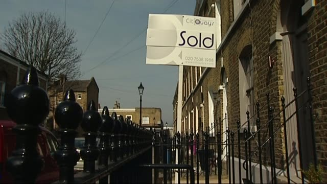 labour ed miliband announces stamp duty plans lib london ext various shots of 'sold' signs outside houses - responsibility stock videos & royalty-free footage