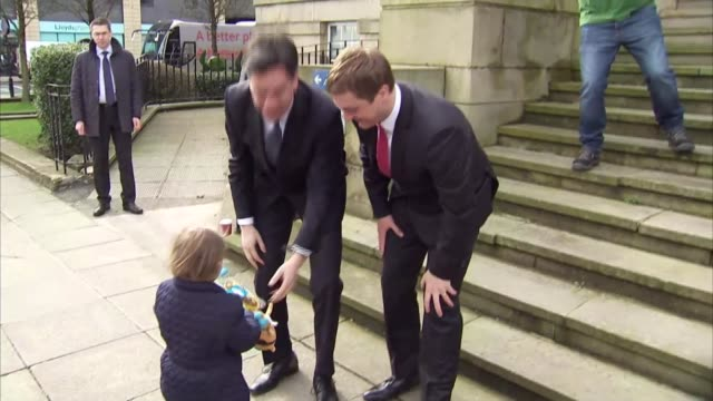 labour party ed miliband arrival for qa england lancashire bury incoming*** ed miliband arrival presented with gift by small boy / miliband up town... - ed miliband stock-videos und b-roll-filmmaterial