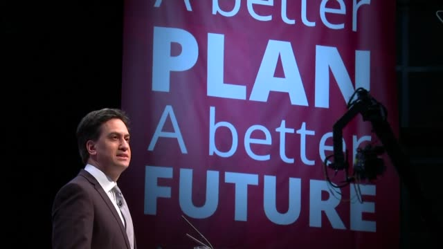 Labour Party manifesto launched Low angle view of Ed Miliband at podium Audience applauding Shadow Chancellor Ed Balls and Labour Party deputy Leader...