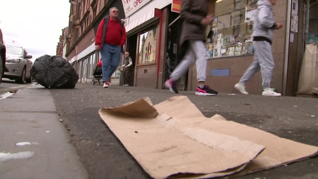 labour party manifesto reactions scotland glasgow ext low angle view of people along street in the parliamentary constituency of glasgow east legs of... - politische gruppe stock-videos und b-roll-filmmaterial