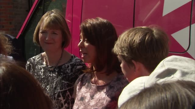general election 2015: labour party women's manifesto launch; harman, de peiro, and cooper next to women's battle bus / harman, de piero, and cooper... - gloria de piero stock videos & royalty-free footage