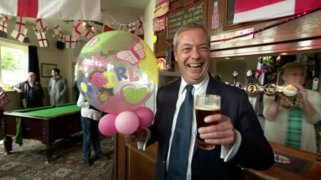 vídeos de stock e filmes b-roll de latest poll has conservatives and labour neck and neck kent ramsgate int nigel farage mep in pub holding pint in one hand and 'baby girl' ballon in... - ramsgate
