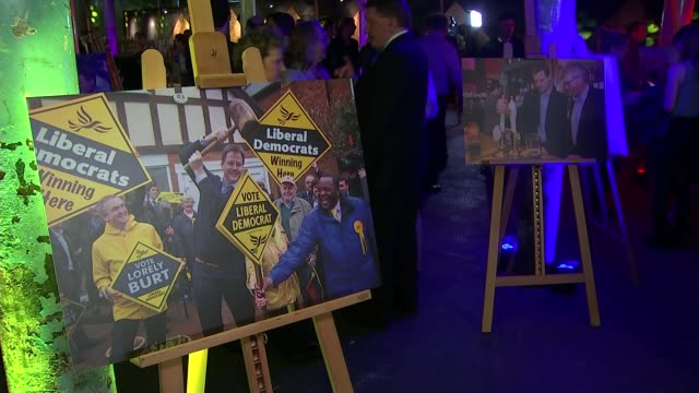 liberal democrats and ukip manifestos launched england london battersea int coloured lights hanging from ceiling people at launch of liberal democrat... - バタシー点の映像素材/bロール