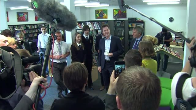 liberal democrats campaigning in cornwall england cornwall st austell int nick clegg with stephen gilbert chatting to supporters in library - st austell stock videos & royalty-free footage