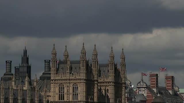 minority government looks the most likely outcome england london big ben clock tower rooftop and spires of house of parlaiment dark clouds along in... - spire stock videos & royalty-free footage