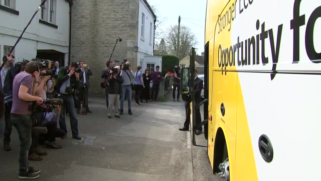 general election 2015: nick clegg visits dymag in chippenham; ext different angle of clegg and others disembarking campaign bus / clegg along / clegg... - チッペナム点の映像素材/bロール