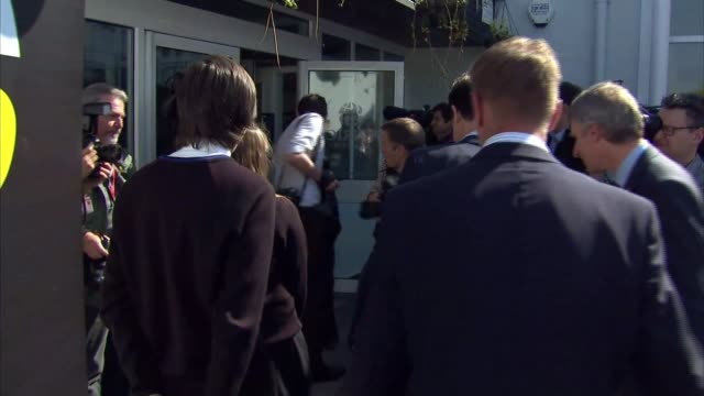 nick clegg visits school in st austell clegg and undentified man along and meeting students outside school clegg chatting to students and adults in... - st austell stock videos & royalty-free footage