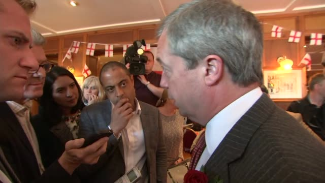 vídeos de stock e filmes b-roll de nigel farage visits ramsgate pub on st george's day further cutaways of nigel farage talking to reporters in pub sot / - ramsgate