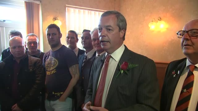 stockvideo's en b-roll-footage met nigel farage visits ramsgate pub on st george's day second camera nigel farage into pub shaking hands with locals and posing for photocal with armed... - ramsgate