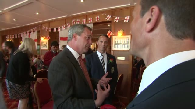 nigel farage visits ramsgate pub on st george's day nigel faraage pint in hand chatting with people in pub/ various of nigel farage talking to group... - ramsgate stock videos and b-roll footage