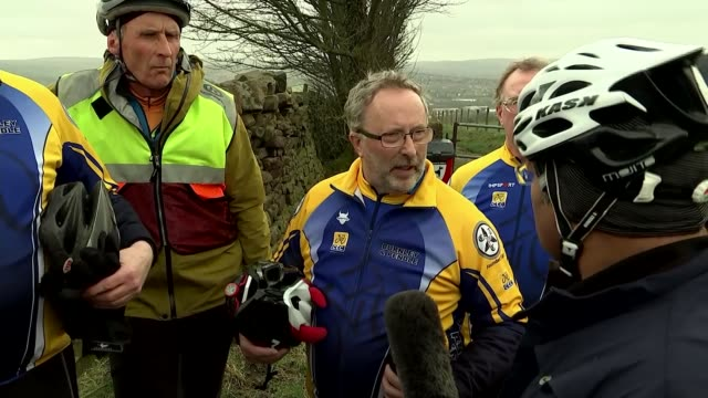 vídeos de stock, filmes e b-roll de northern velocity nelson in lancashire england lancashire nelson ext pendle cyclist's touring club members along on bikes reporter talking to... - lancashire