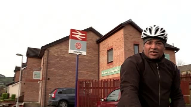 northern velocity whalley in lancashire reporter to camera as riding bicycle sign at whalley railway station reporter to camera as riding bike sign... - bicycle parking station stock videos and b-roll footage