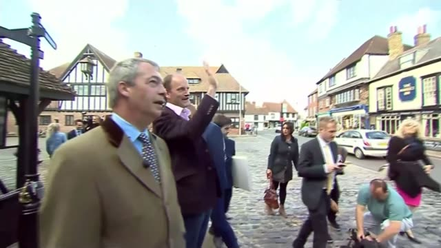 Party leaders campaign across the country ENGLAND Kent Nigel Farage talking to elderly women Farage waving with press around Nigel Farage speaking to...