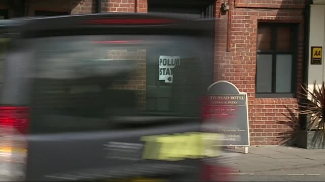 general election 2015: polling day / party leaders cast their votes; portable polling station set up in car park in unidentified location / wales:... - big hair stock videos & royalty-free footage