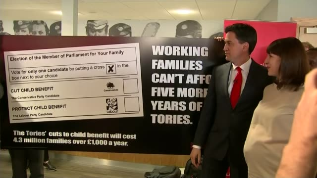 possible postelection deals / child benefit row england bristol photography** ed miliband photocall with rachel reeves standing with supporters... - party poster stock videos & royalty-free footage