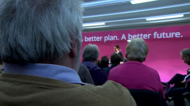 row over labour's plan to scrap 'nondom' tax status obscured shot of miliband at podium side view miliband at podium hands of miliband gesturing at... - itvイブニングニュース点の映像素材/bロール